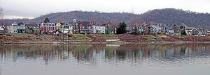 Wheeling Island - Buildings on Wheeling Island as viewed across the east channel of the Ohio River from downtown Wheeling in 2006.  The hills in the background are in Belmont County, Ohio.