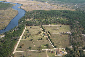White Oak Conservation - An aerial photo shows some of the animal enclosures on the White Oak property. At left is the St. Marys River, which separates Georgia and Florida.