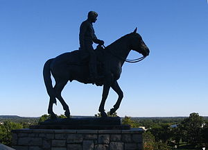 Sculpture of Will Rogers on a horse on the gro...