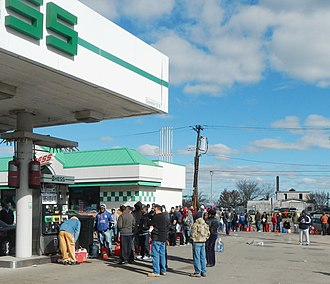Clifton, Staten Island - Clifton residents wait to fill fuel cans after Hurricane Sandy.