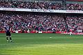 Wojciech Szczesny watches Mikel Artetas free kick (6867687342).jpg