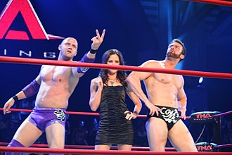 Nigel McGuinness - Wolfe, Chelsea and Magnus posing in the ring in July 2010