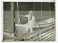 "Woman posing on the lifeboat of the ""Mariposa"" (AM 79745-2).jpg"