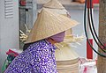 Woman with hat and mouth swab on Vietnam.jpg