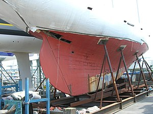 Wooden hull being repaired.jpg
