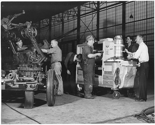 Workers take a few precious minutes for some much needed refreshment from the plant luch wagon. At the left a 37mm... - NARA - 196206