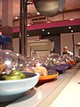 Yo! Sushi containers on the conveyor belt.jpg