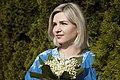 День Вишиванки. Молода україночка у вишитій синій сукні серед квітів 15.jpg