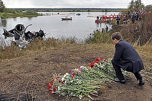 Lokomotiv Yaroslavl plane crash - Russian President Dmitry Medvedev lays flowers near the remains of the rear stabilizer and some landing gear of the Yak-42D that carried the Lokomotiv Yaroslavl hockey squad.