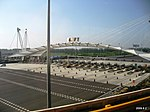 北京机场快轨由T3前往T2途中, 远处是机场高速收费站 - panoramio.jpg