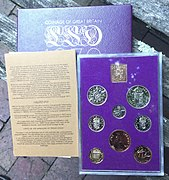 A set of shiny coins in a plastic case, with a paper case of issue and a piece of literature from the set