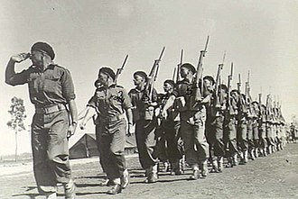 2/7th Commando Squadron (Australia) - Parade Atherton Tableland, Queensland. 1944-09-11. B Troop, 2/6th Cavalry Commando Regt, salute during the march past.