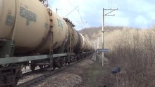 Файл:2ES4K-134 with tank freight train.webm