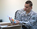 316th ESC soldiers receive care packages from home 120724-A-JW984-922.jpg