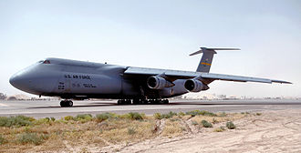 """436th Operations Group - 436th Operations Group Lockheed C-5B Galaxy, 87-033 """"Spirit of the Tuskegee Airmen"""", waits for clearance to taxi out on the parking ramp at Balad Air Base, Iraq. This aircraft has since been reassigned to the 439th OG at Westover Air Reserve Base, Massachusetts, the first C-5B to be assigned to the Air Force Reserve."""