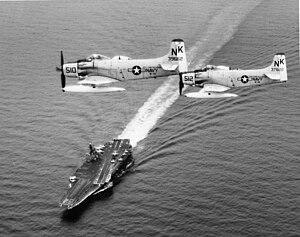 VA-145 (U.S. Navy) - Image: A 1H Skyraiders of VA 145 in flight over USS Constellation (CVA 64), circa 1964 (NNAM.1996.253.2786)