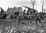 AA gun crews Armentieres March 1916 IWM Q 460.jpg