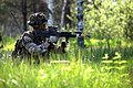 A British soldier aims a rifle during a simulated attack as part of exercise Saber Strike 2013 in Adazi, Latvia, June 6, 2013 130606-O-ZZ999-005.jpg
