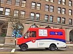 A Canada Post mail delivery bus in Cambie Street, Vancouver, Canada.jpg