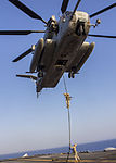 A U.S. Marine assigned to Battalion Landing Team 3-2, 26th Marine Expeditionary Unit (MEU), fast ropes from a CH-53 Super Stallion assigned to Marine Medium Tiltrotor Squadron (VMM) 266 (Reinforced), 26th MEU 130630-M-SO289-012.jpg