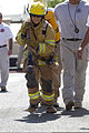 A U.S. Navy customs officer participates in the Fire Prevention Week firefighter challenge at Camp Arifjan, Kuwait, Oct. 6, 2013 131006-A-OP586-088.jpg