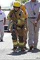 A U.S. Navy customs officer participates in the Fire Prevention Week firefighter challenge at Camp Arifjan, Kuwait, Oct. 6, 2013 131006-A-OP586-088.jpg