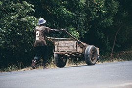 A man pushing a cart with goods to the market.jpg