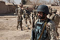 A member, right, of 3rd Kandak, 3rd Brigade, Afghan National Civil Order Police, participates in a dismounted patrol in Sher'Ali Kariz, Maiwand district, Kandahar province, Afghanistan, Feb 120225-A-QD683-066.jpg