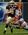 Aaron Polanco carries the ball at 2004 Emerald Bowl 041230-N-9693M-404.jpg