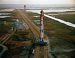 Aerial view of the Apollo 9 space vehicle on the way from the Vehicle Assembly Building to Pad A.jpg