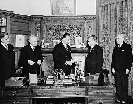 At Rideau Hall, Governor General the Viscount Alexander of Tunis (centre) receives the bill finalizing the union of Newfoundland and Canada on March 31, 1949 Alexander-NFLD.jpg