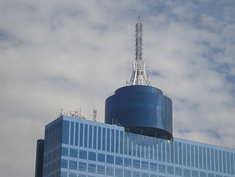 World Trade Center Mexico City - Antenna and spiral tower. The XHFO-FM antenna shown here is the one replaced in 2009, which brings the building's height to 207.1 meters.