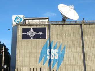 "Special Broadcasting Service - The wall of the SBS carpark in Artarmon, showing the ""Mercator"" logo used from 1993 to 2008"