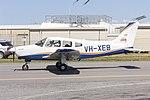 Australian Airline Pilot Academy (VH-XEB) Piper PA-28-161 Cherokee Warrior III taxiing at Wagga Wagga Airport.jpg