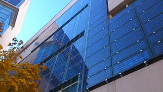 Building-integrated photovoltaics - BAPV solar facade on a municipal building located in Madrid (Spain).