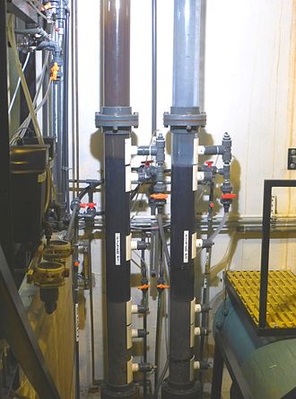 Backwashing (water treatment) - Backwashing cycle is run on the left filter of the test columns in a water filtration plant.