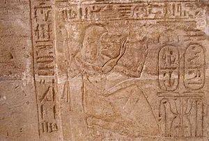 Bay (chancellor) - Chancellor Bay on the doorjamb of the Amada temple, Nubia, shown adoring the cartouche of Siptah