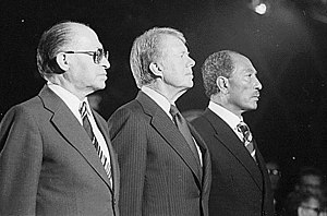 History of modern Egypt - Celebrating the signing of the Camp David Accords: Menachem Begin, Jimmy Carter, Anwar Al Sadat.