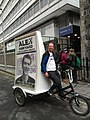 Bicycle towed advertising billboard during an Edinburgh University Students' Association Elections.jpg