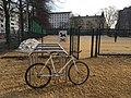 Bike racks and no bikes sign (29747598857).jpg