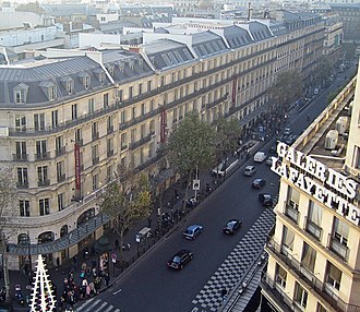 Mansard roof - Mansard rooftops along Boulevard Haussmann in Paris constructed during the Second French Empire.