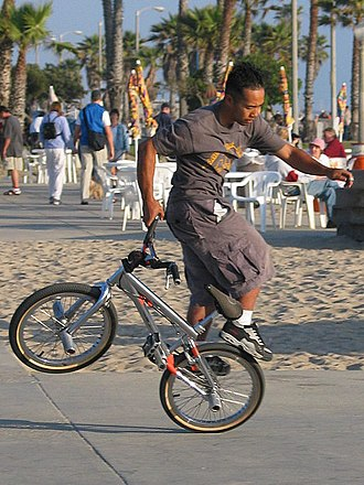 Freestyle BMX - BMX Flatland rider Caleb Rider at Santa Monica beach.