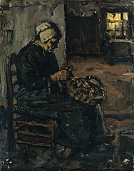 Rural woman peeling potatoes