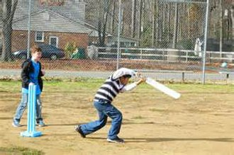 Cricket in the United States - A Sri Lankan-American child playing cricket in the US state of Virginia.