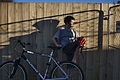 Boy with a bicycle against a wooden fence, Auckland - 0168.jpg