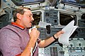 Brown on aft flight deck with microphone during STS-95.jpg