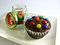 Brownie Cupcake topped with chocolate near a glass jar.jpg
