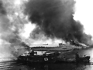 Burning Japanese barges and boats.jpg