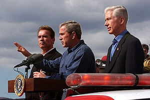 Governor-elect Arnold Schwarzenegger, President George W. Bush, and Governor Gray Davis speak to firefighters on November 4, 2003.