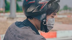 Canva - Selective Focus Photography of Person Wearing Black and Red Helmet and Gray Mask.jpg